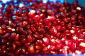 Bright red seeds of a ripe and ready to eat pomegranate.