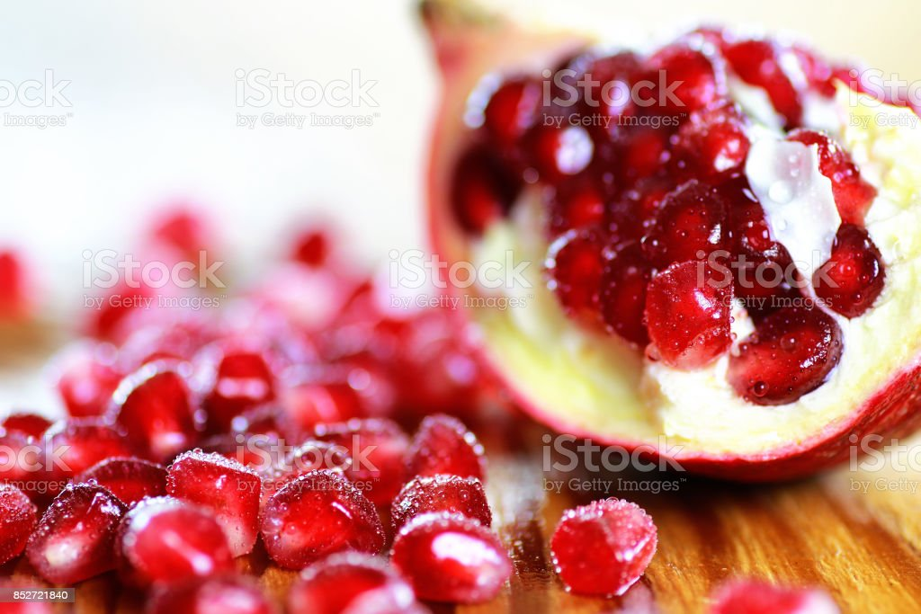 pomegranate seed wood background stock photo