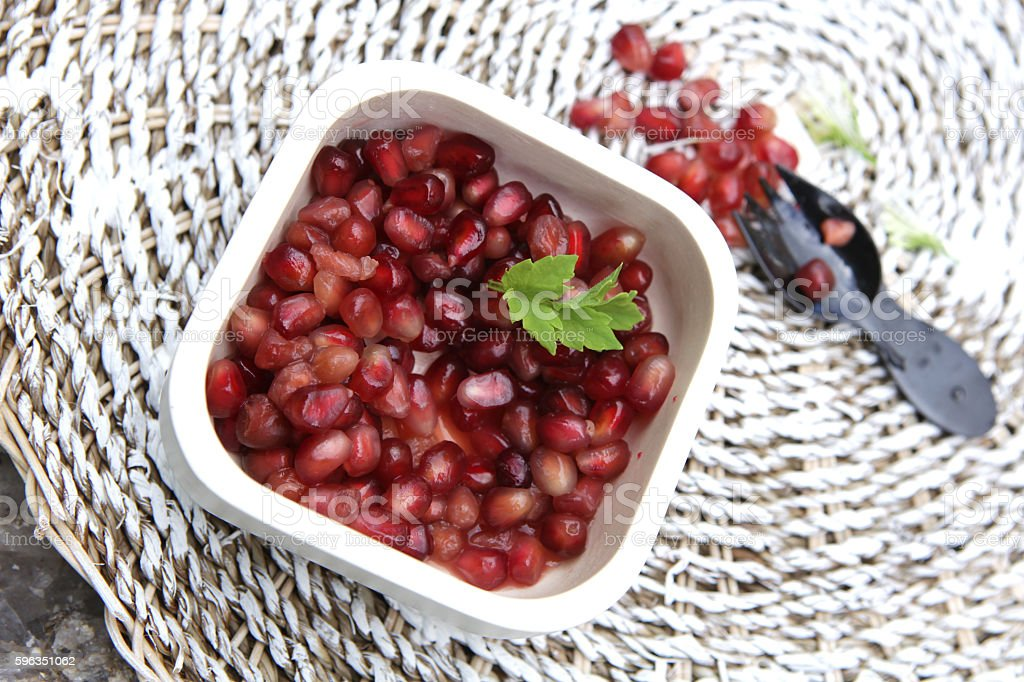 Pomegranate seeds with mint and black fork Lizenzfreies stock-foto