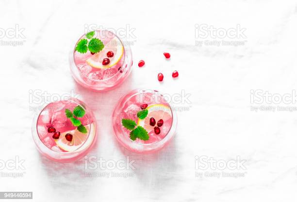 Pomegranate tequila cocktail summer light alcoholic drink cooling on picture id949446594?b=1&k=6&m=949446594&s=612x612&h=iak4jbcn6f qdxdhcncnkcohecxbf097qceim4xgt3a=