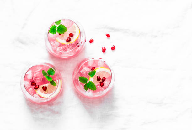 pomegranate tequila cocktail. summer light alcoholic drink,  cooling aperitif. on light background, top view, free space. flat lay - напиток стоковые фото и изображения