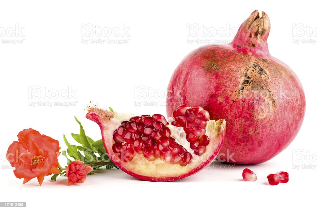 Pomegranate with leaves and flowers stock photo