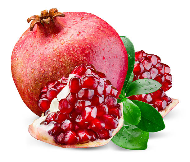 Pomegranate with piece and leaves. Isolated on a white background. stock photo