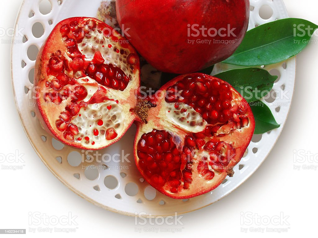 Pomegranates in a plate stock photo