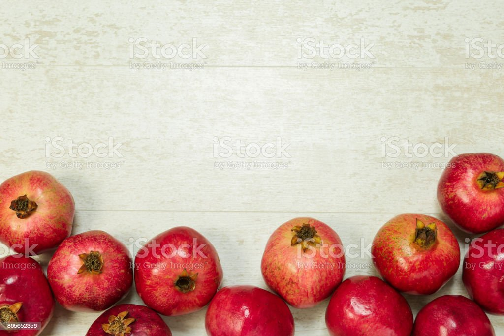 Pomegranates on wooden background Top view with a copy space stock photo