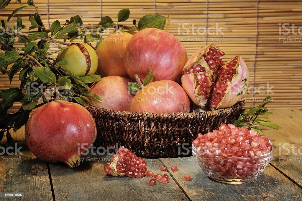 pomegranates on wooden board royalty-free stock photo