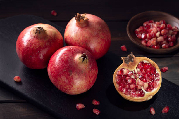 Pomegranates still life in low key. Close up. Punica granatum stock photo