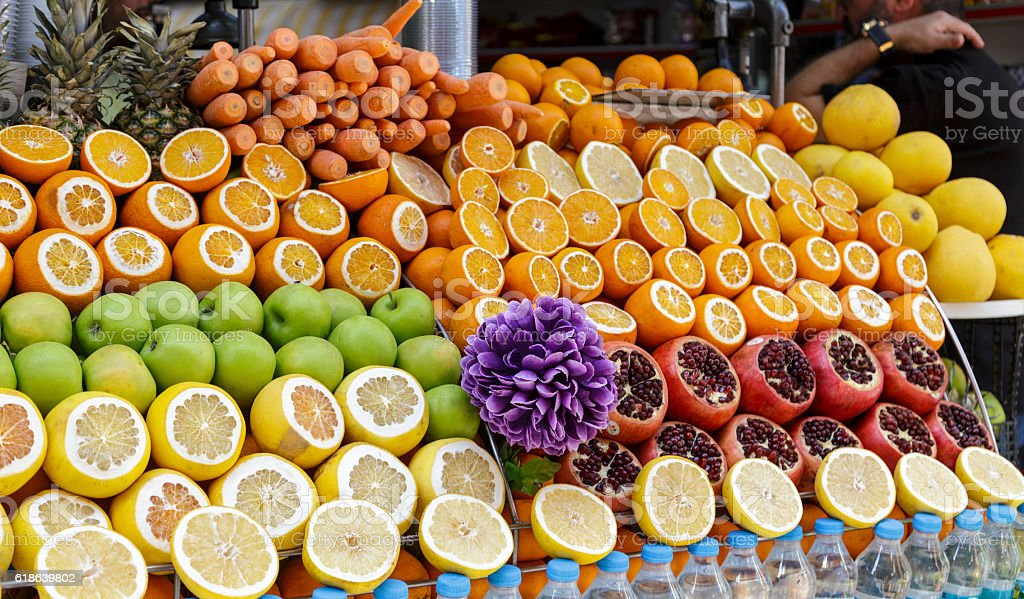 Pomegranates,oranges and apple at the street market in Istanbul, stock photo