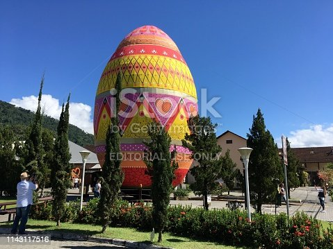 Pomerode, Santa Catarina, Brazil - April 09, 2019: Image of people and the Guiness World Record Easter Egg from the artists Silvana Pujol and João Siqueira with the Record Holder for the world's largest decorated Easter egg in 2019 located in Pomerode, Santa Catarina state - Brazil
