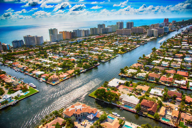 Pompano Beach and Fort Lauderdale Area From Above The Intracoastal Waterway as it bisects a residential neighborhood in the Pompano Beach area of South Florida just north of Fort Lauderdale. canal stock pictures, royalty-free photos & images