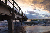 Pompano Beach Pier Broward County Florida at the Beach by sunrise and stormy weather