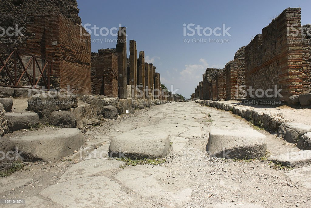 Pompei street with brick wall royalty-free stock photo