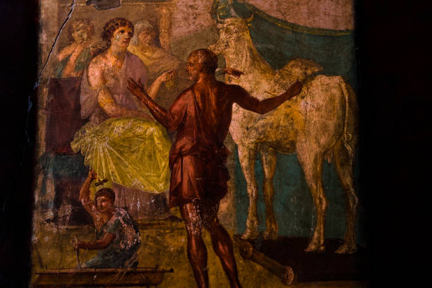Pompeii, Italy Roman domus house of Vettii fresco painting. North wall triclinium mythological scene depicting Daedalus and Pasiphae. Remains after Mount Vesuvius volcanic eruption in 79 AD. stock photo