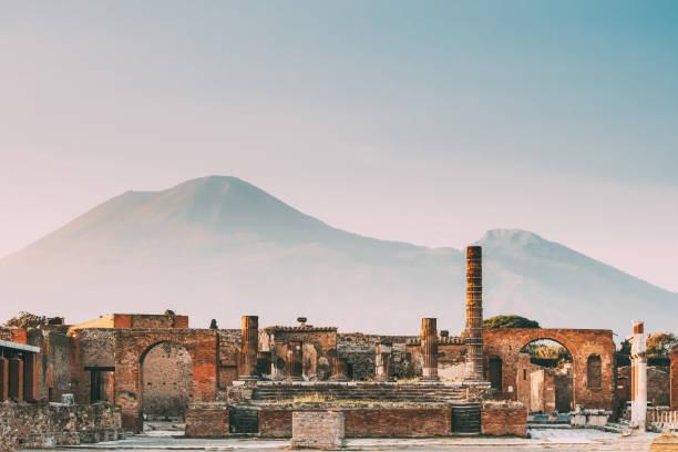 Pompeii, Italy. Temple Of Jupiter Or Capitolium Or Temple Of Capitoline Triad On Background Of Mount Vesuvius stock photo