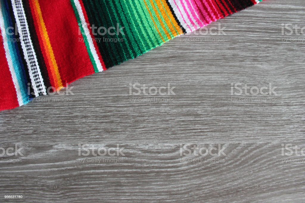 poncho mexican background wooden wood grain copy space for text serape fiesta culture theme stock photo