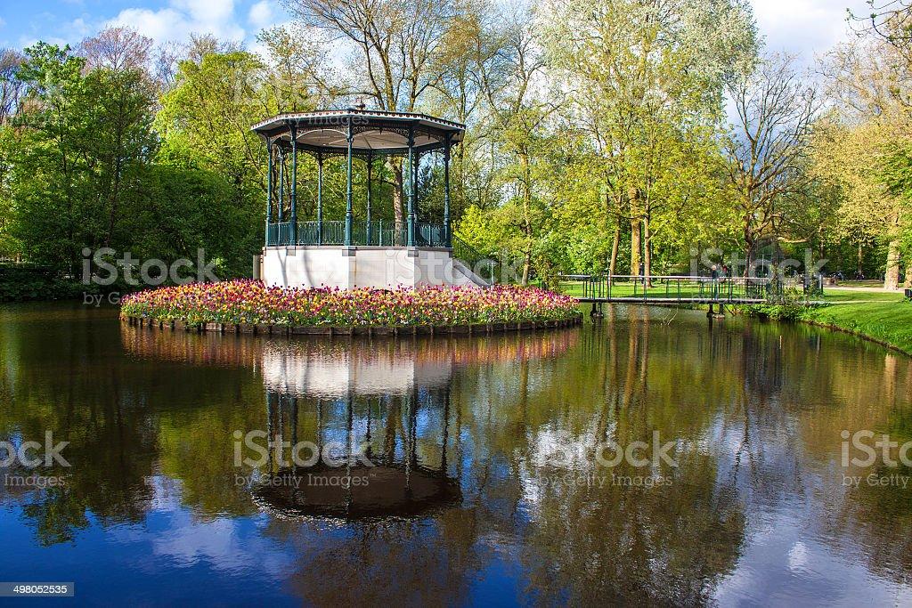 Pond and tulips in Vondelpark stock photo