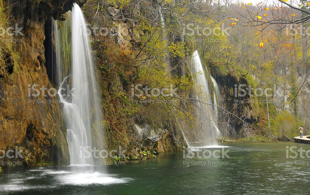 Pond and waterfalls in lush vegetation royalty-free stock photo