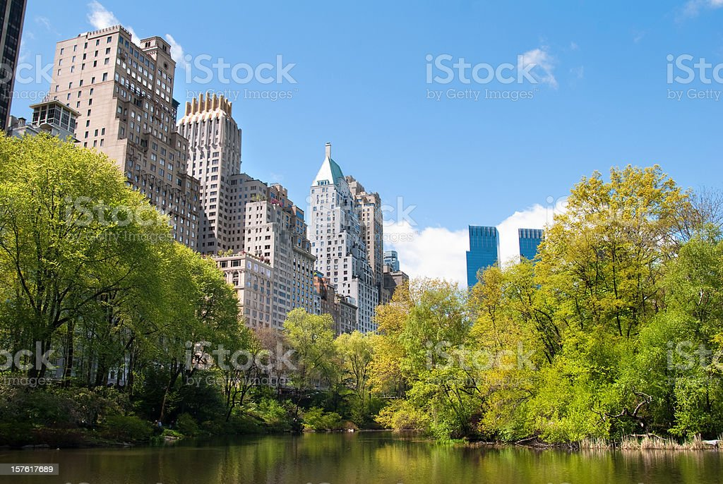 Pond at Central Park with skyscrapers in background royalty-free stock photo