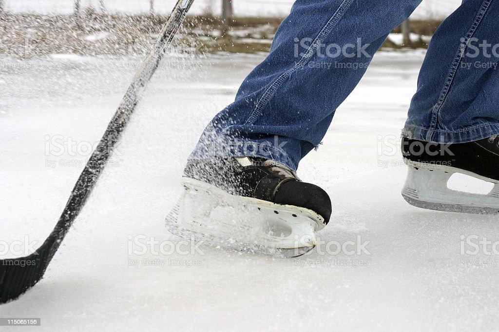 Pond Hockey; skate spray royalty-free stock photo
