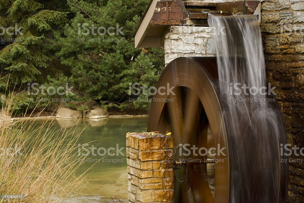 Pond setting with water wheel. royalty-free stock photo