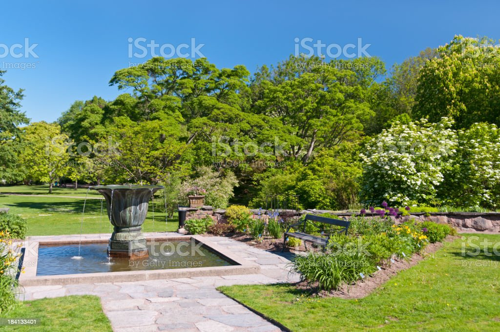 Pond with urn in Botanical garden royalty-free stock photo