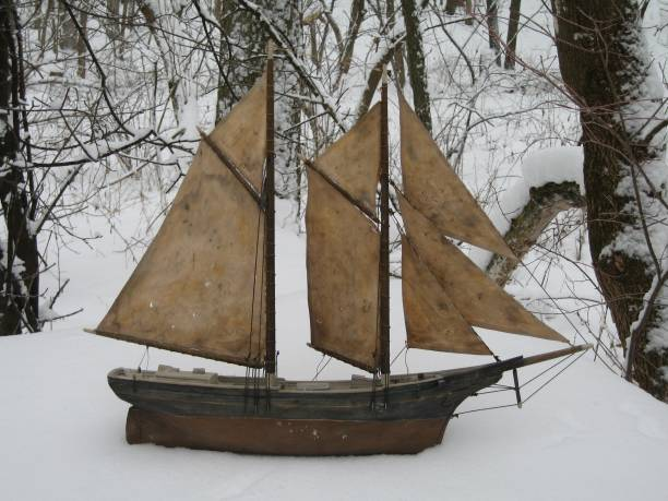 Pond Yacht In The Snow stock photo