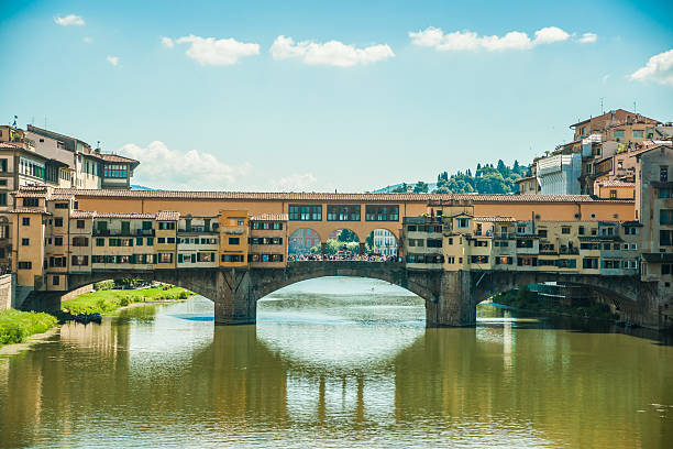 pone vecchio over arno river in florence, italy. - pone stock photos and pictures