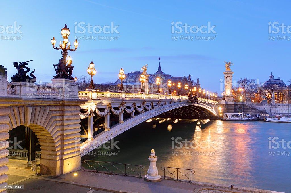 Pont Alexandre III and Grand Palais at dusk, Paris. stock photo