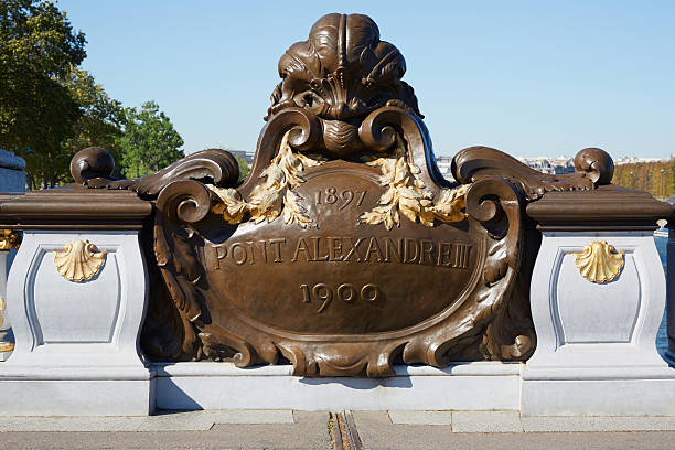 Pont Alexandre III bridge balustrade emblem in Paris Pont Alexandre III bridge balustrade emblem in Paris, early morning early 20th century stock pictures, royalty-free photos & images