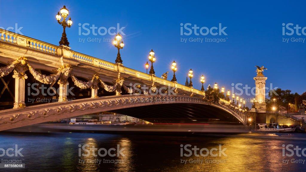 Pont Alexandre III bridge illuminated with the Seine River. Paris, France stock photo