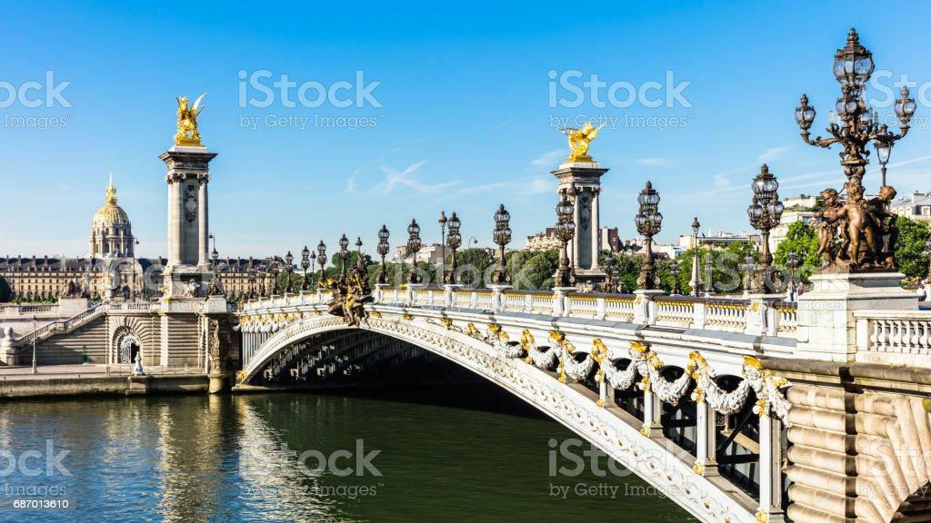 Pont Alexandre III Bridge with Hotel des Invalides. Paris, France stock photo
