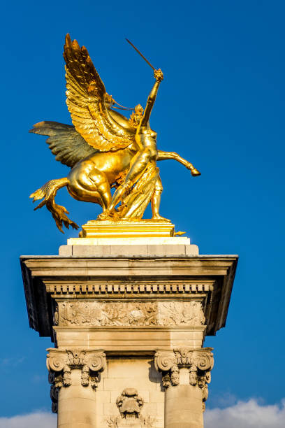 pont alexandre iii, the gilded statue of fame, paris - pegasus stock photos and pictures
