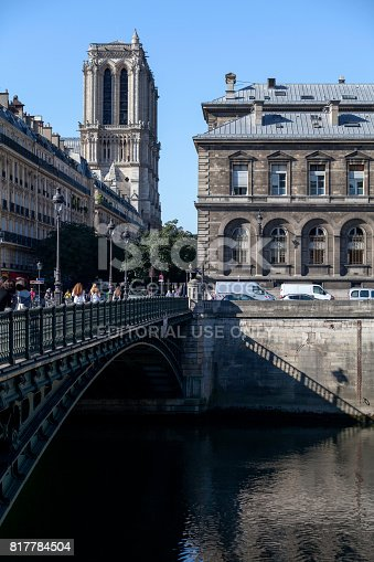 Paris, France - July 17 2017: Pont d'Arcole over the Seine river with Notre-Dame Cathedral and the Hotel Dieu Hospital behind.