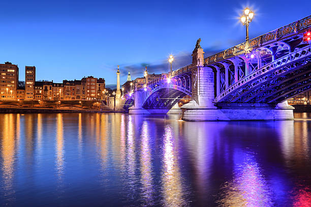 Pont de Fragnee by night, green. Pont de Fragnee by night in Liege, Belgium lulik stock pictures, royalty-free photos & images