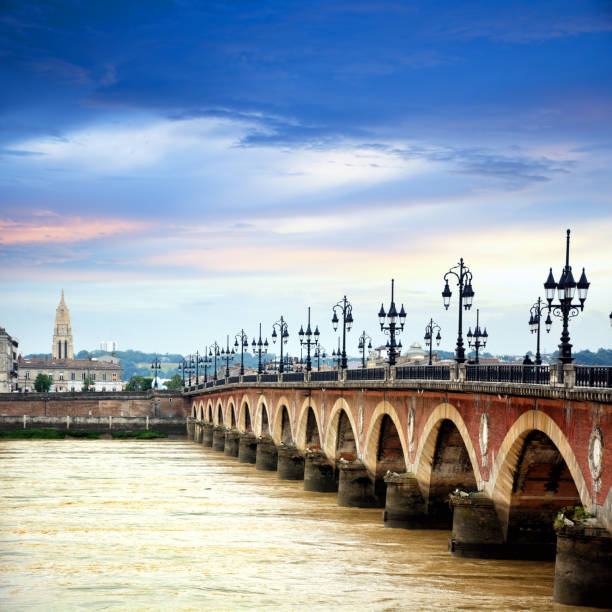 Pont de pierre, Bordeaux The Pont de pierre or Stone Bridge in Bordeaux, France. Composite photo bordeaux stock pictures, royalty-free photos & images
