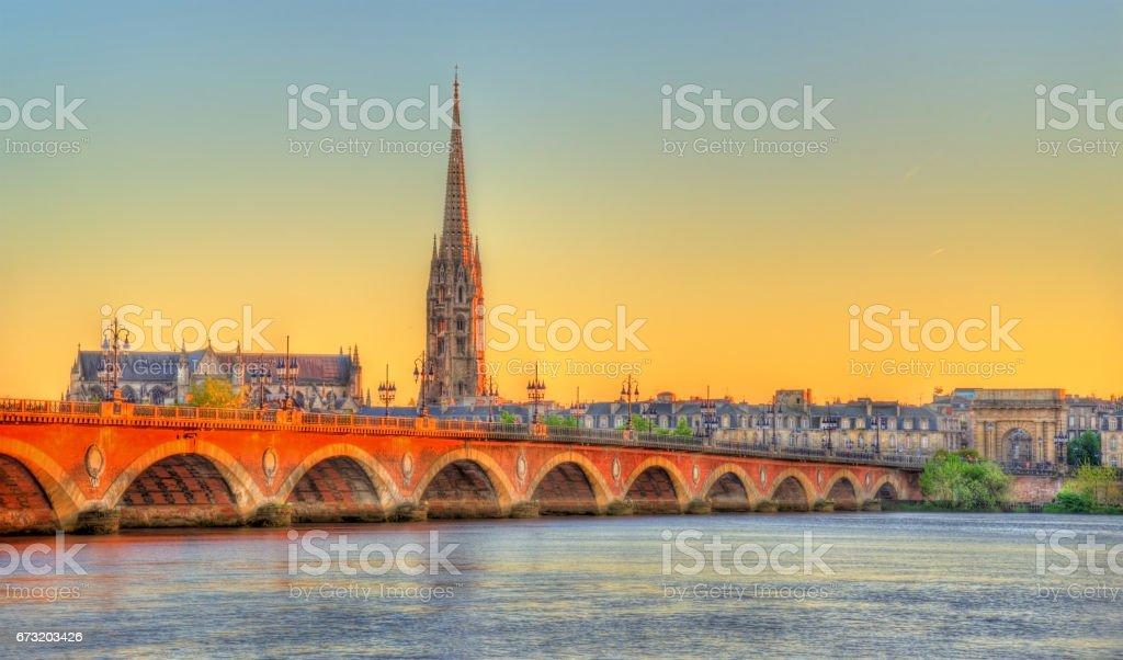 Pont de Pierre bridge and Saint Michel Basilica in Bordeaux, France - Photo