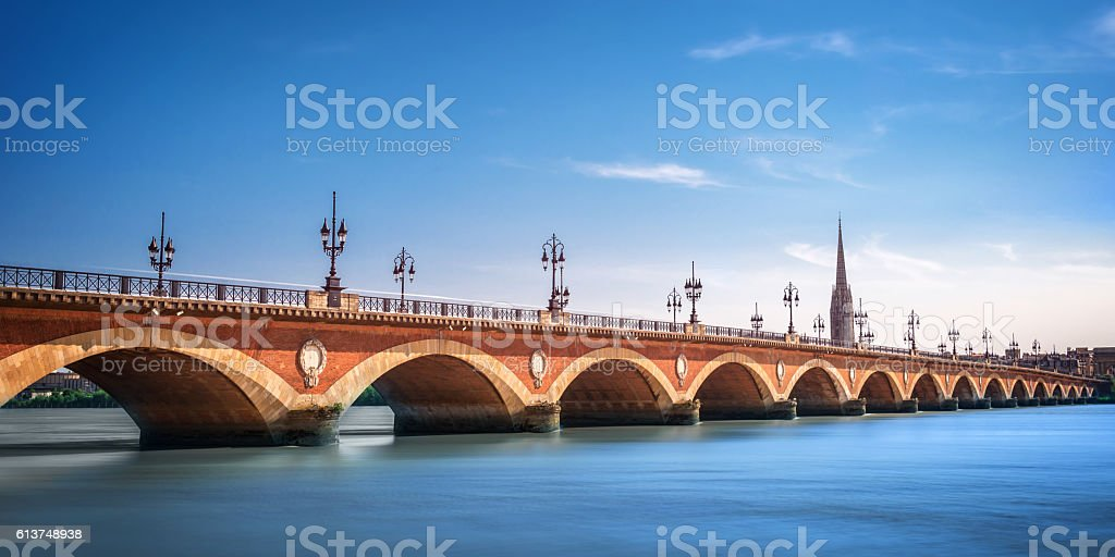 Pont de Pierre bridge with St Michel cathedral, Bordeaux, France stock photo