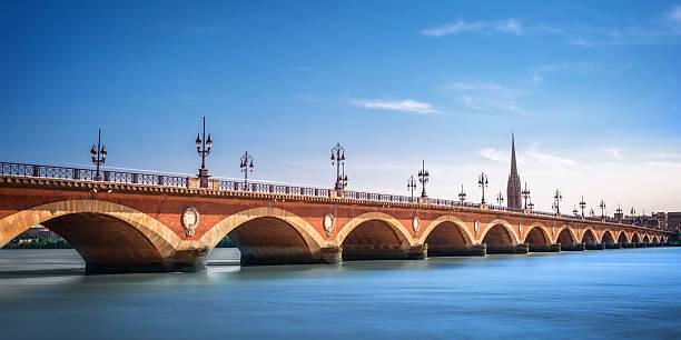 Pont de Pierre bridge with St Michel cathedral, Bordeaux, France Pont de Pierre bridge with St Michel cathedral, Bordeaux, France bordeaux stock pictures, royalty-free photos & images