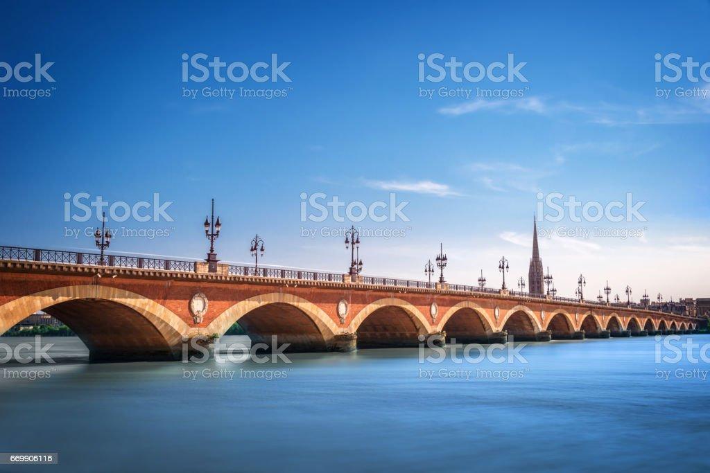 Pont de Pierre bridge with St Michel cathedral, Bordeaux, France - Photo