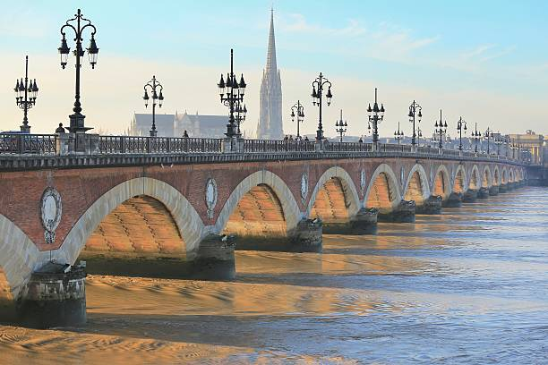 Pont de Pierre Morning light shine on Pont de Pierre bridge, Bordeaux, France  bordeaux stock pictures, royalty-free photos & images