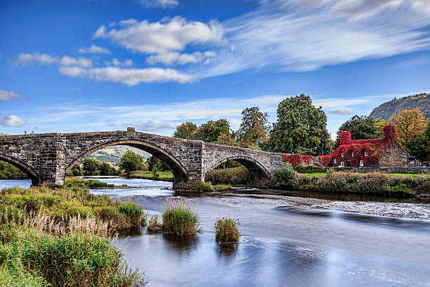 Pont Fawr Pont Fawr, famous medieval stone bridge across the river Conwy, and court house covered in red ivy  Llanrwst, Caernarfon, North Wales wales stock pictures, royalty-free photos & images