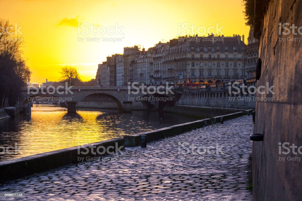 Pont Neuf over the Seine next to Notre Dame Cathedral at Sunrise stock photo