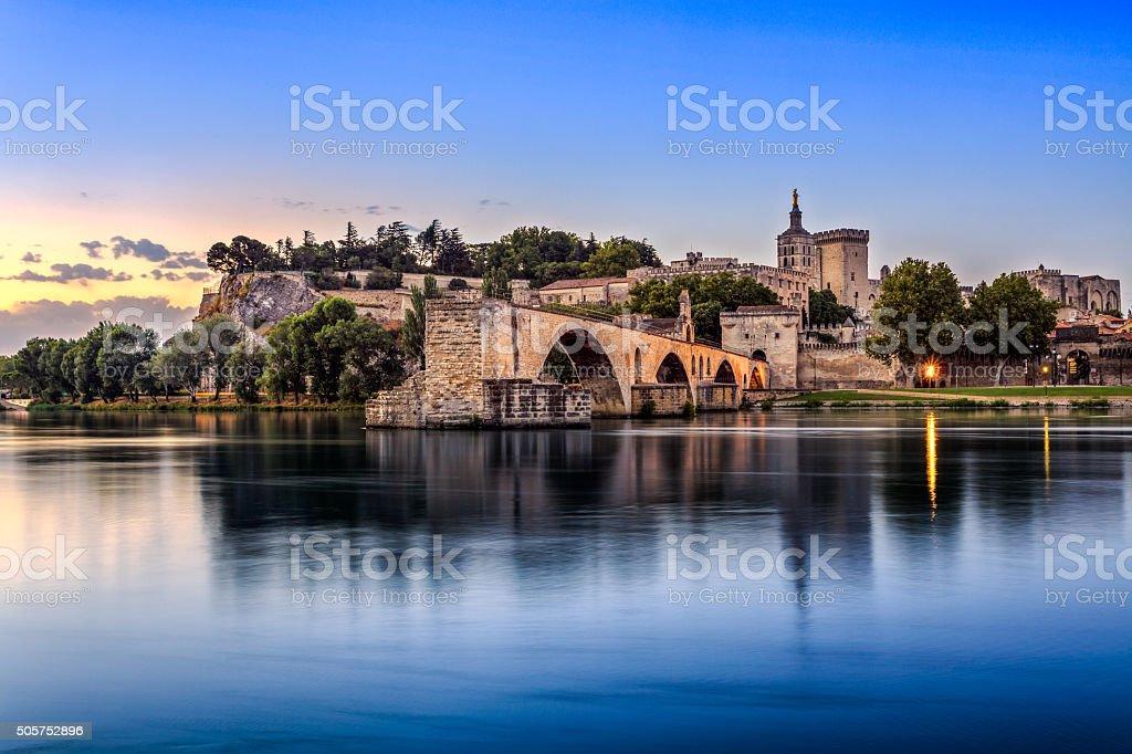 Pont Saint-Benezet at sunrise Avignon Bridge with Popes Palace and Rhone river at sunrise, Pont Saint-Benezet, Provence, France Activity Stock Photo
