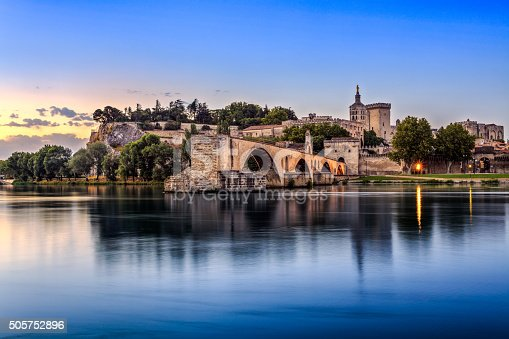 Avignon Bridge with Popes Palace and Rhone river at sunrise, Pont Saint-Benezet, Provence, France