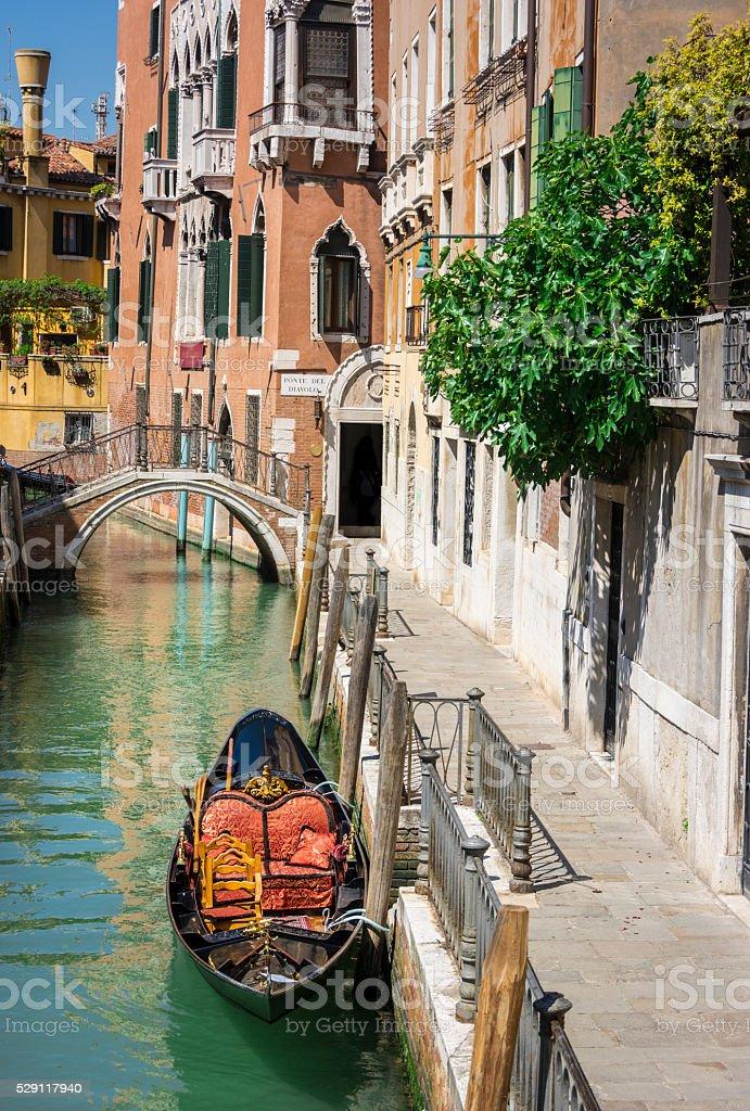 Ponte del diabolo and a canal with gondola, Venice, Italy stock photo