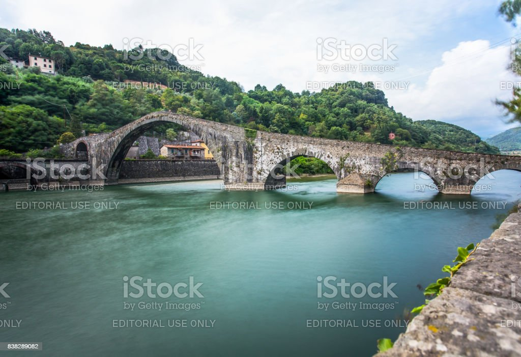 Ponte della Maddalena, Borgo a Mezzano, Lucca, Italy, important medieval bridge in Italy. Part of historical Via Francigena trade route in Tuscany. stock photo