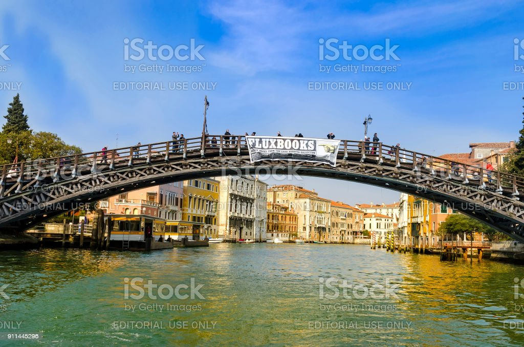 Ponte dell'Accademia in Venice from motorboats on grand canal stock photo
