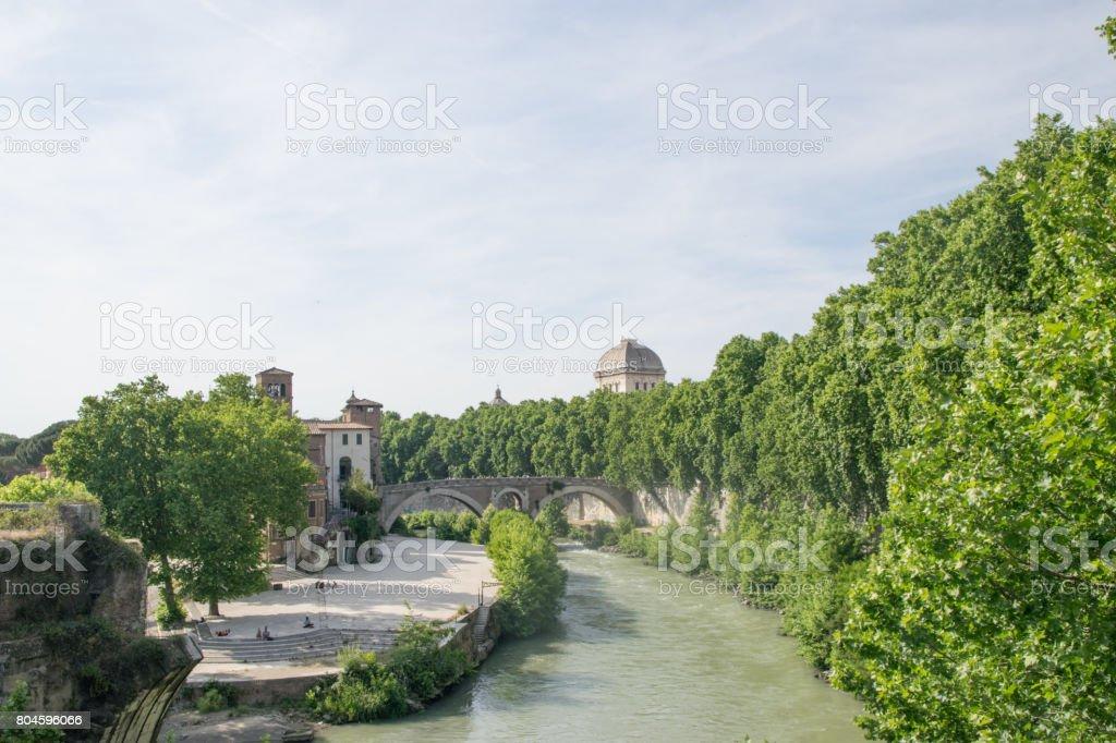 Ponte Fabricio and Isola Tiberina in Rome, Italy. Fabricius Bridge is the oldest Roman bridge in Rome stock photo
