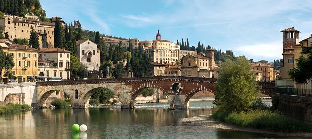 Ponte Pietra (Stone bridge) - 1st century B.C. - the oldest Roman monument in Verona (UNESCO world heritage site) and the Adige river, Veneto, Italy