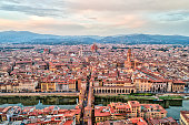Aerial View of Ponte Vecchio, Duomo of Santa Maria del Fiore and Florence at Sunset